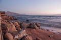 Dahab restaurant and sun rise with mountains and sea in morning Stock Photos