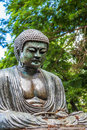 Daibutsu a replica of the great buddha of kamakura at foster botanical gardens on oahu hawaii Stock Photo