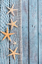 Dainty fishnet border with small orange starfish Royalty Free Stock Photo
