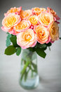 Dainty yellow pink roses in a vase beautiful bouquet of Stock Photography