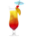 Daiquiri cocktail with fresh tropical fruit with clipping path colourful orange and red diced in an elegant glass a umbrella Royalty Free Stock Images