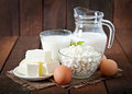 Dairy products and eggs on a wooden table Royalty Free Stock Images