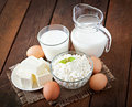 Dairy products and eggs on a wooden table Stock Photos