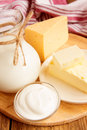 Dairy products milk cheese butter sour cream over wooden table Stock Photography