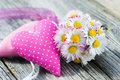 Daisies with hearts on wood Stock Photography