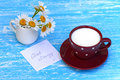 Daisy flowers and cup of milk with good morning note Royalty Free Stock Photo