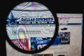 Dallas cowboys photo of the homepage on a monitor screen through a magnifying glass Stock Photos