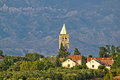 Dalmatian village of zaton and velebit church tower mountain croatia Stock Photos