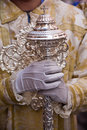 Dalmatic or white robe in a liturgical act of holy week sceptre silver spain Stock Images