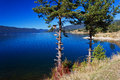 A dam lake mountain lake on the clear blue sky background Royalty Free Stock Images