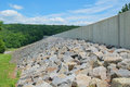 Dam wall with boulders shown is bolstered by prompton pennsylvania Royalty Free Stock Images