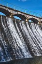The dam and waterfall on the river Lomnica Royalty Free Stock Photo