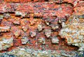 Damaged brick wall of red color. Vintage background, old weathered texture. Shabby surface of grunge masonry. Vintage facade. Royalty Free Stock Photo