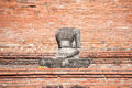 Damaged buddha statue in the grounds of wat mahathat ayutthaya thailand june headless at on june is one s Stock Images