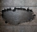 Damaged metal armor with torn hole steam punk background Royalty Free Stock Photography