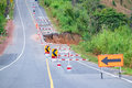 Damaged road with caution Royalty Free Stock Photo