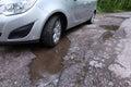 Damaged road full of cracked potholes Royalty Free Stock Photo