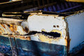 Damaged rowboat detail image of a that used to belong to the local fishermen Stock Images