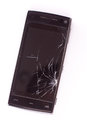 Damaged smart phone on white background Royalty Free Stock Images
