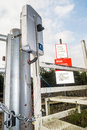 Damaged vandalised railway crossing phone and associated signage kirkby in ashfield england august in kirkby in ashfield Royalty Free Stock Photography