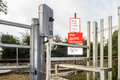 Damaged vandalised railway crossing phone kirkby in ashfield england august and associated signage in kirkby in ashfield Royalty Free Stock Image