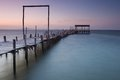 Damaged wood pier a fishing at carrasqueira alcacer do sal portugal by the sea Stock Photography