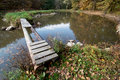 Damaged wooden bridge to the small island in autumn nature Royalty Free Stock Photos