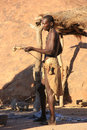 Damara man namibia epupa may portrait of an unidentified building a pipe the are indigenous peoples living in northern Stock Photo