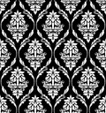 Damask style design of floral arabesques black and white in a heavy repeat seamless pattern suitable for print and textile Stock Images