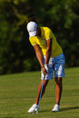 Dame Pro Golfer Strike Ball   Stock Fotografie