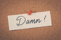 Damn note pinned on the bulletin board Royalty Free Stock Photography