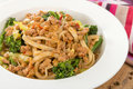 Dan dan noodles chinese with minced pork and sprouting broccoli in a fragrant spicy sauce sichuan cuisine Stock Photography