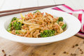 Dan dan noodles chinese with minced pork and sprouting broccoli in a fragrant spicy sauce sichuan cuisine Royalty Free Stock Image