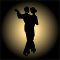 Dance night slow couple silhouette on a black glowing background Stock Image