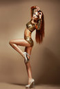 Dance nightclub gorgeous redhead woman in golden bikini fancy dress party classy gold Royalty Free Stock Images