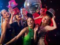 Dance party with group people dancing and disco ball. Royalty Free Stock Photo