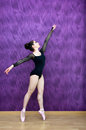 Dancer ballet dancing in a purple background Royalty Free Stock Photo