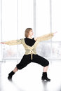 Dancer female doing lunge in class Royalty Free Stock Photo