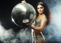 Dancer girl in smoke with disco ball night club Royalty Free Stock Photography