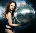 Dancer girl in smoke with disco ball studio shot Royalty Free Stock Photo