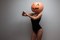 Dancer with halloweens pumpkin dancing go go female on head Royalty Free Stock Photography