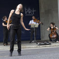 Dancer and musicians. Royalty Free Stock Photography