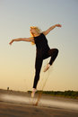 Dancer on road professional gymnast woman posing concrete Royalty Free Stock Photography