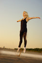 Dancer on road professional gymnast woman posing concrete Stock Photography