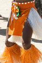Dancer of the south see legs a in traditional breechcloth and bast fiber on on beach aitutaki a small island Stock Photos
