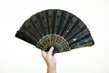 Dancer's hand holding a black fan. Royalty Free Stock Photo