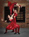 Dancers in action against brick wall Stock Images