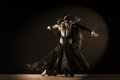 Dancers in ballroom against on black background Royalty Free Stock Photo