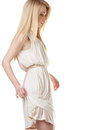 Dancing blond woman with long hair on white Stock Image