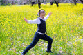 Dancing boy in the flower field listening to music Stock Image